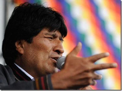 """Bolivian President Evo Morales delivers a speech during the celebration for the reincorporation of Bolivia to the UN Convention Against Illicit Traffic in Narcotic Drugs in La Paz on January 14, 2013. """"The coca leaf is not any more seen as cocaine (..), it is a victory of our identity"""" said Morales. AFP PHOTO/Jorge Bernal"""