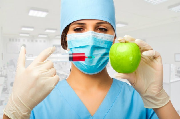 chemist%20with%20syringe%20and%20apple.jpg