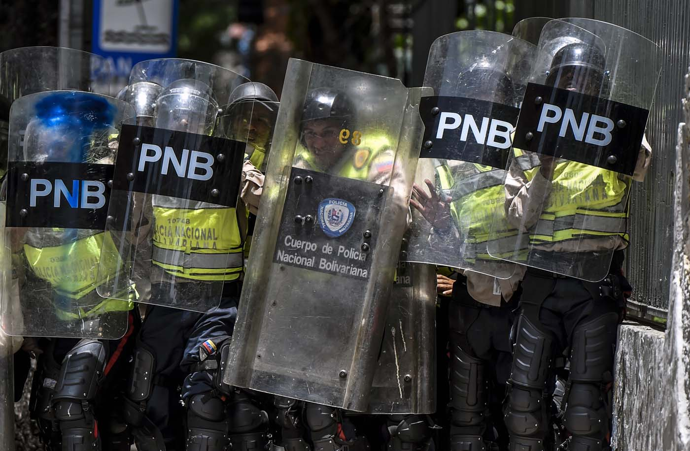 Bolivarian police agents hold their shields and prepare for confrontation during a protest against Nicolas Maduro