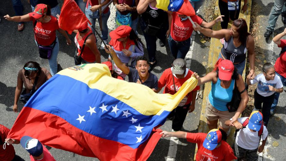 Demonstrators in support of President Nicolas Maduro's government march towards downtown Caracas on April 19, 2017. Venezuela braced for rival demonstrations Wednesday for and against President Nicolas Maduro, whose push to tighten his grip on power has triggered waves of deadly unrest that have escalated the country's political and economic crisis. / AFP PHOTO / FEDERICO PARRA (Photo credit should read FEDERICO PARRA/AFP/Getty Images)