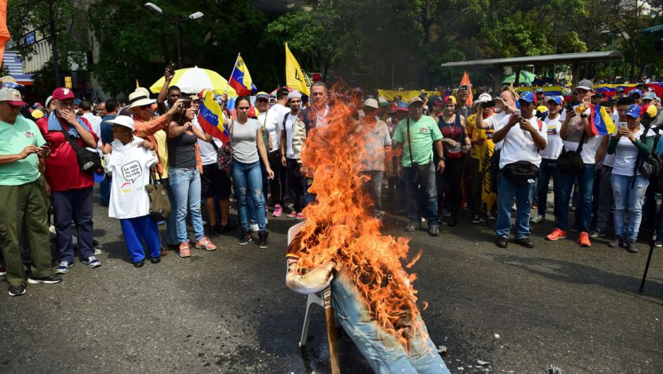 Demonstrators burn an effigy of President Nicolas Maduro during a protest at the east side of Caracas on April 19, 2017. Venezuela braced for rival demonstrations Wednesday for and against President Nicolas Maduro, whose push to tighten his grip on power has triggered waves of deadly unrest that have escalated the country's political and economic crisis. / AFP PHOTO / RONALDO SCHEMIDT (Photo credit should read RONALDO SCHEMIDT/AFP/Getty Images)