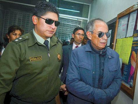 El exvocal del Tribunal Departamental de Justicia de La Paz, Fernando Ganam, cuando fue aprehendido en 2016. Foto: APG - archivo