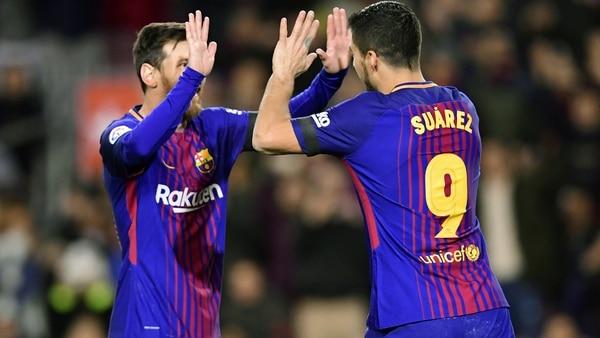 Lionel Messi y Luis Suárez con la actual equpiación (AFP)