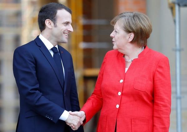 Junto a Angela Merkel, canciller alemana