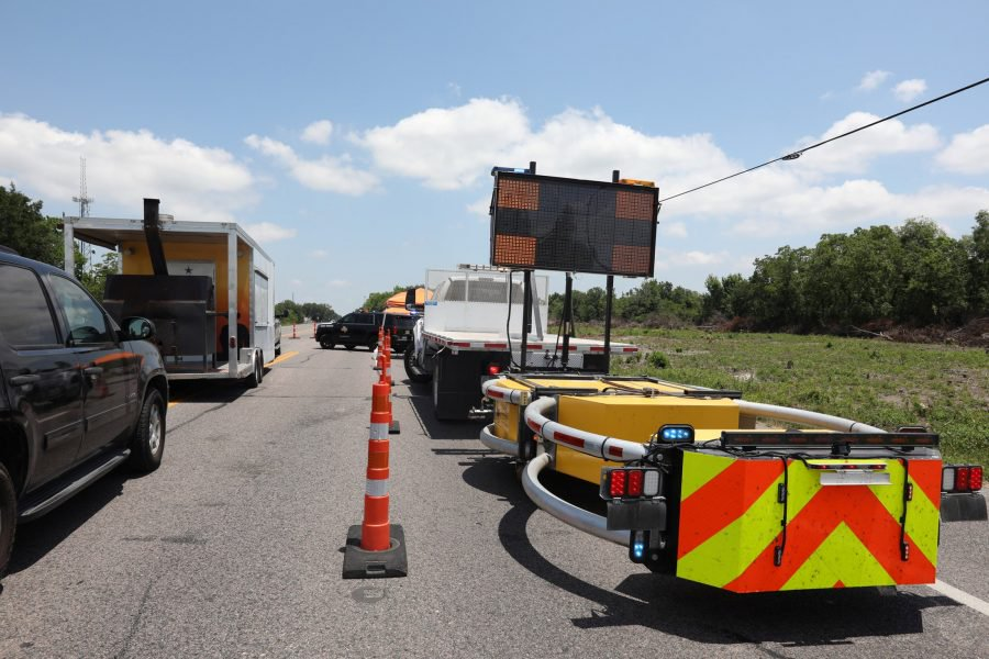 Police keep a roadblock on a main road to Santa Fe High School where police found explosives after an early morning shool shooting that left several people dead in Santa Fe, Texas, U.S., May 18, 2018.  REUTERS/Trish Badger