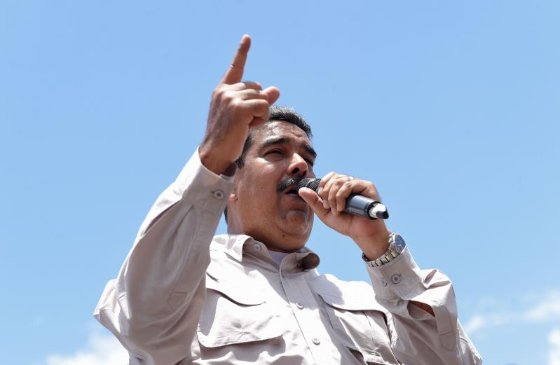 TOPSHOT - Venezuelan President Nicolas Maduro delivers a speech during a campaign rally in Charallave, about 65 km from Caracas, on May 15, 2018. - Venezuela holds presidential elections on May 20, in which Maduro is seeking a second six-year term. (Photo by Juan BARRETO / AFP) (Photo credit should read JUAN BARRETO/AFP/Getty Images)