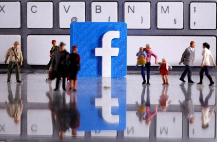 FILE PHOTO: FILE PHOTO: A 3D printed Facebook logo is placed between small toy people figures in front of a keyboard in this illustration taken April 12, 2020. REUTERS/Dado Ruvic/Illustration/File Photo/File Photo