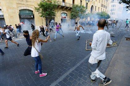 Las corridas en las calles (REUTERS/Thaier Al-Sudani)