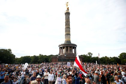 People attend a rally against the government's restrictions following the coronavirus disease (COVID-19) outbreak, in Berlin, Germany August 29, 2020. REUTERS/Axel Schmidt