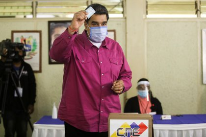 El dictador chavista llega al puesto del votación el domingo. REUTERS/Fausto Torrealba NO RESALES. NO ARCHIVES