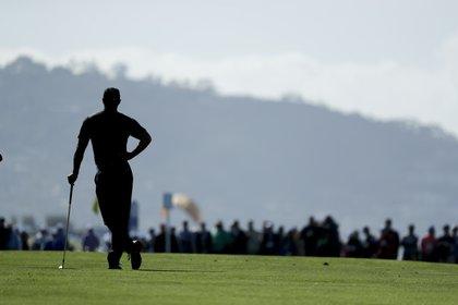 Tiger Woods rompió prejuicios y cambió el golf para siempre. Fue el primer negro en triunfar en el torneo de Augusta. (AP Photo/Gregory Bull)